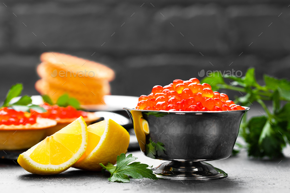 Red salmon fish caviar, salmon caviar in metal bowl. Caviar. Selective focus - Stock Photo - Images