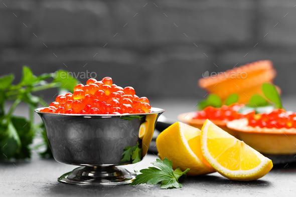 Red salmon fish caviar, salmon caviar in metal bowl. Caviar. Selective focus - Stock Photo - Images