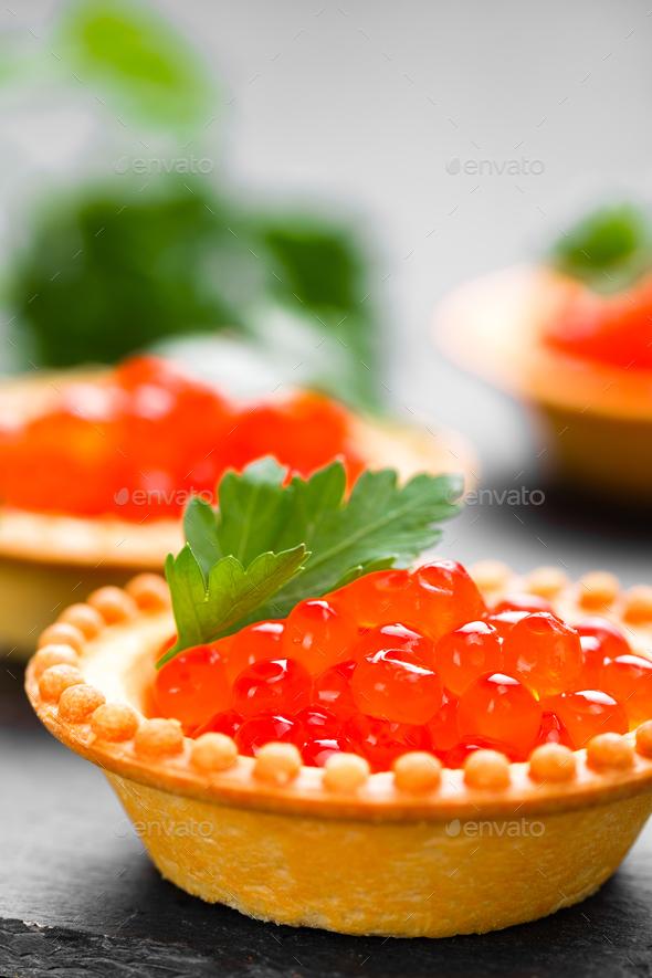 Tartalets with red salmon fish caviar, salmon caviar. Caviar. Selective focus - Stock Photo - Images
