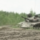 Military Tank in Movement on a Dirt Ground Terrain - VideoHive Item for Sale