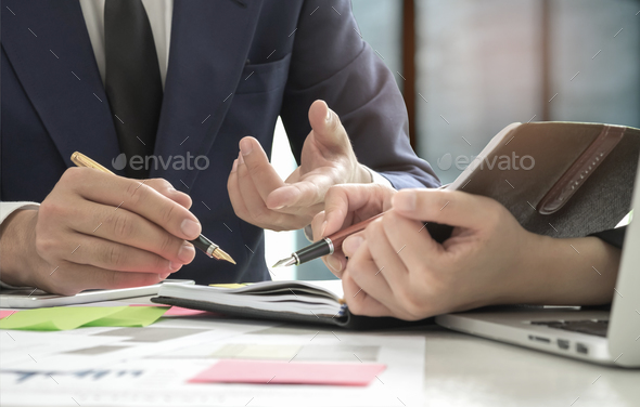 Management is executing the secretary is taking notes - Stock Photo - Images