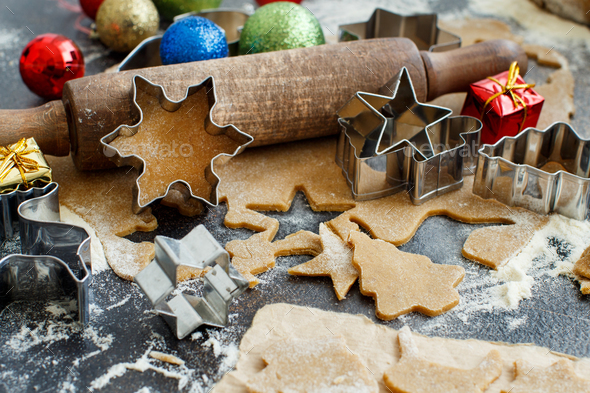 Cooking cookies with  cookie cutters and christmas decorations - Stock Photo - Images