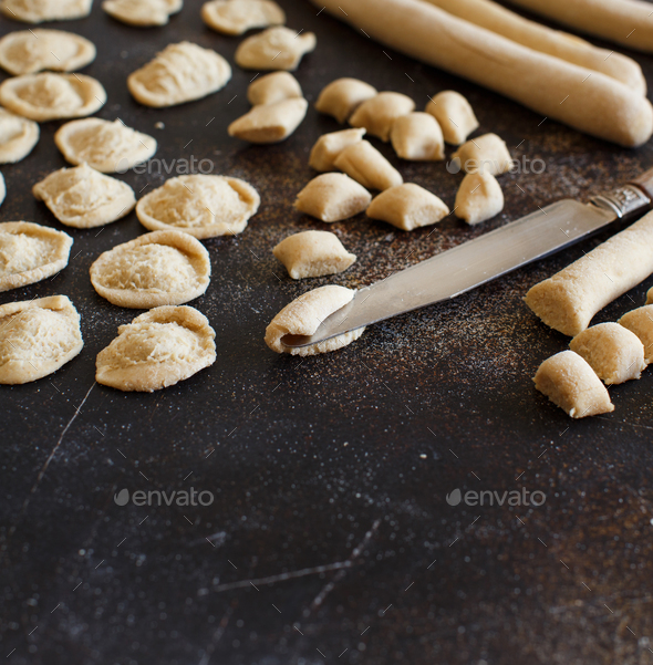 Making whole wheat flour pasta orecchiette - Stock Photo - Images