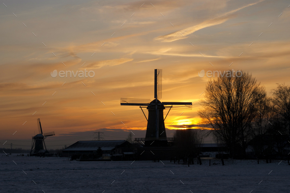 Windmills at sunset - Stock Photo - Images