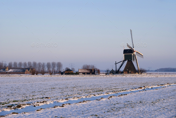 Windmill in a snow covered landscape - Stock Photo - Images