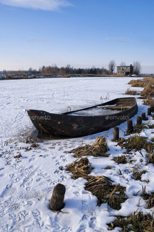 Rowing boat in a frozen river - Stock Photo - Images