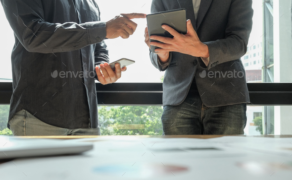 Two office workers are analyzing data,Business concepts. - Stock Photo - Images