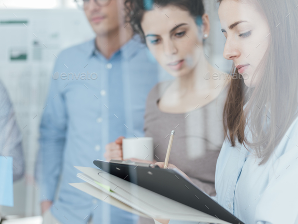 Young business team meeting in the office - Stock Photo - Images