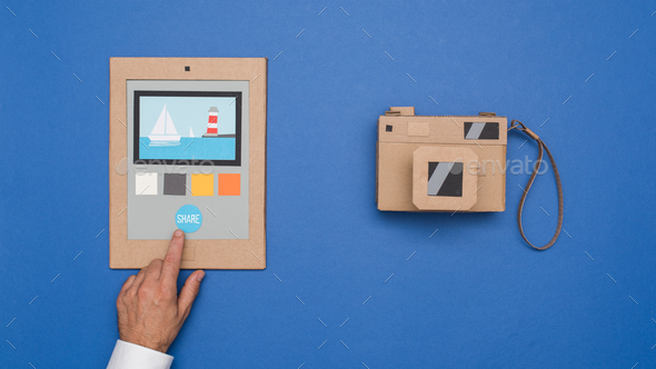 Photo editing on a cardboard tablet - Stock Photo - Images