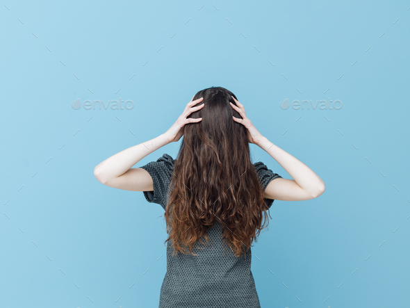 Woman with face covered behind her hair - Stock Photo - Images