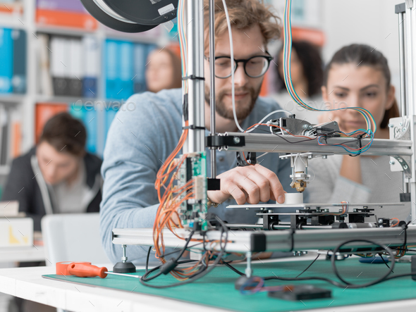 Students using a 3D printer - Stock Photo - Images