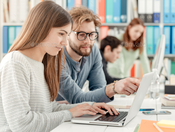 University students studying together - Stock Photo - Images