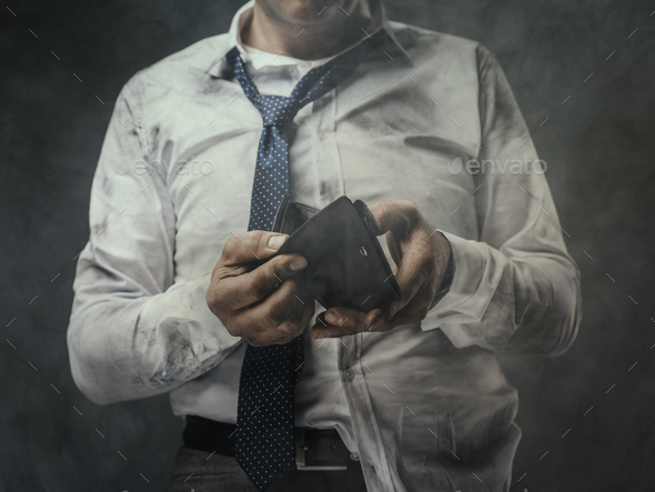 Jobless businessman with empty wallet - Stock Photo - Images