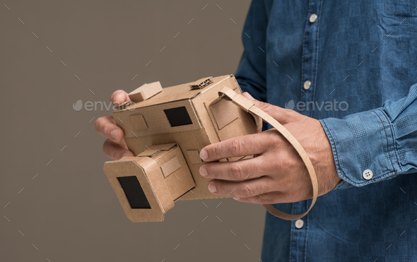 Photographer holding a cardboard camera - Stock Photo - Images