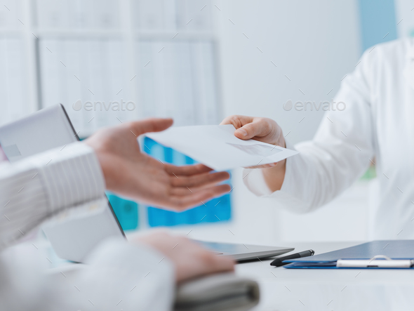 Doctor and patient meeting in the office - Stock Photo - Images