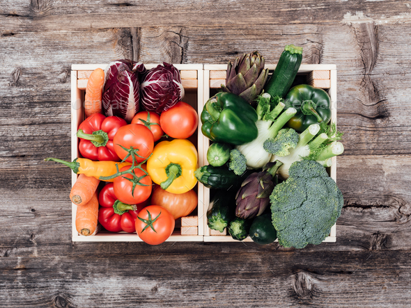 Fresh tasty vegetables in wooden crates - Stock Photo - Images
