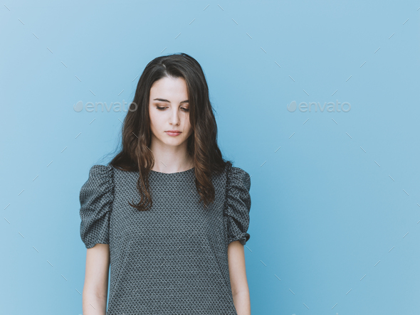 Elegant girl looking down - Stock Photo - Images