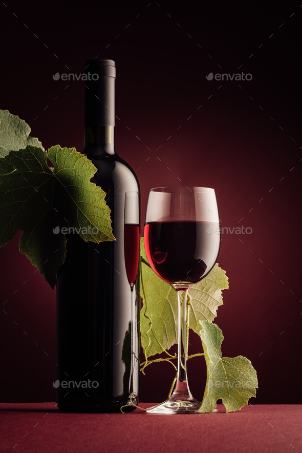 Red wine bottle and wineglass - Stock Photo - Images