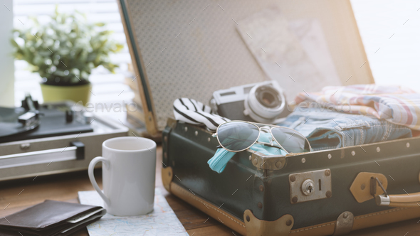 Traveler packing his suitcase before leaving - Stock Photo - Images