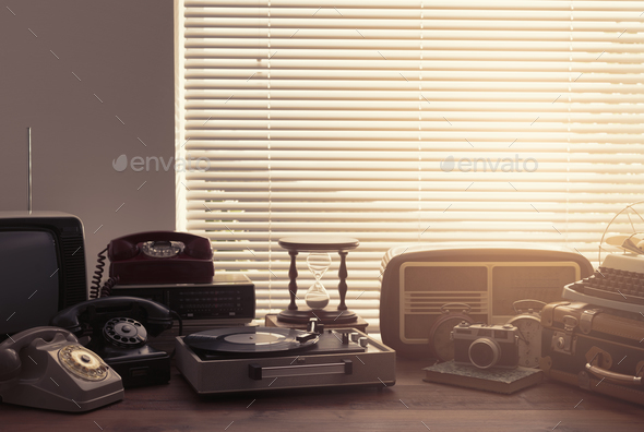 Vintage objects collection next to a window - Stock Photo - Images