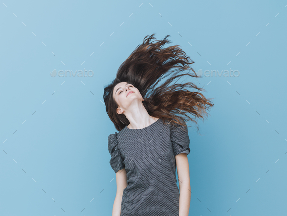 Beautiful girl moving hair - Stock Photo - Images