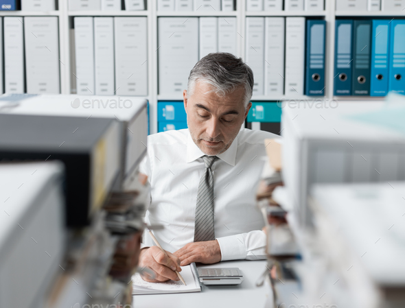 Manager overloaded with work - Stock Photo - Images