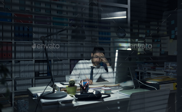 Business executive working late at night - Stock Photo - Images