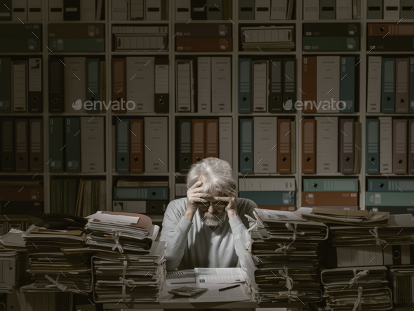 Overloaded senior office worker - Stock Photo - Images