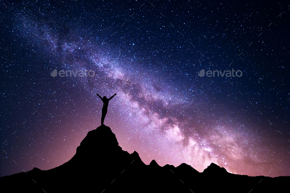 Milky Way with  silhouette of a standing sporty girl - Stock Photo - Images