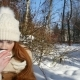 Ginger-Haired Teenage Girl Walking and Drinking a Hot Tea on Winter Park - VideoHive Item for Sale