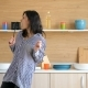 Happy Woman Dancing and Singing in the Kitchen - VideoHive Item for Sale