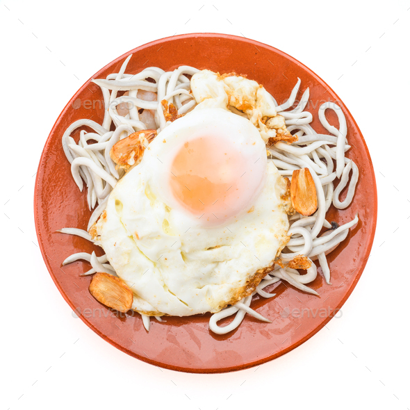 overhaed shot fried egg with baby eels isolated on white - Stock Photo - Images