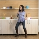 Happy Young Woman in the Kitchen Dancing and Singing - VideoHive Item for Sale