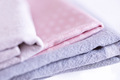 stack of fabrics over marble table - PhotoDune Item for Sale