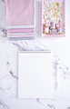 White Empty Notebook with sewing items over marble table - PhotoDune Item for Sale