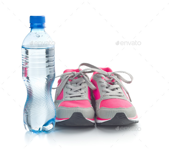 Sports shoes and a bottle of water. - Stock Photo - Images