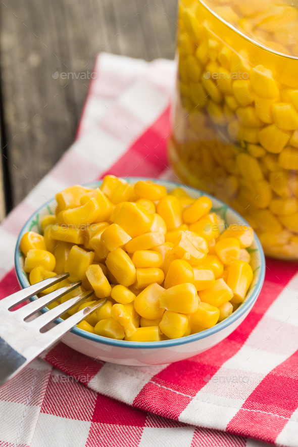 Corn seeds in bowl. - Stock Photo - Images