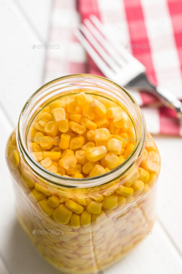 Corn seed in glass jar . - Stock Photo - Images
