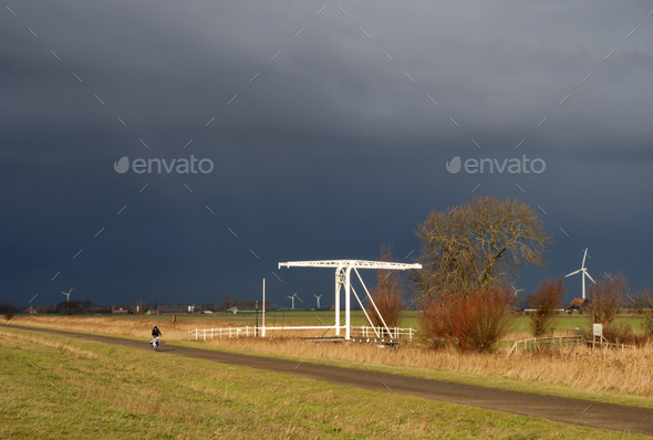 Cyclist in bad weather - Stock Photo - Images