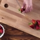Woman Slicing Strawberries for Dessert in Kitchen - VideoHive Item for Sale
