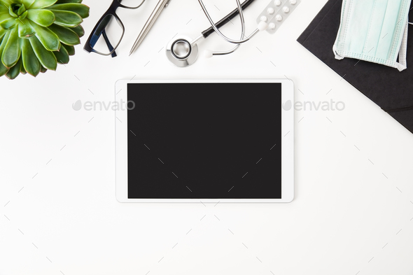 Digital Tablet With Blank Screen And Medical Equipment On Table - Stock Photo - Images