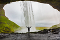 Woman With Arms Raised Standing In Front Of Seljalandsfoss - PhotoDune Item for Sale