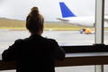 Woman Looking At Airplane Through Window At Airport - PhotoDune Item for Sale