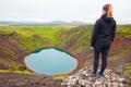 Woman Looking At Kerid Crater Lake - PhotoDune Item for Sale