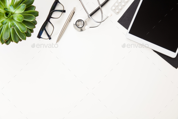 Digital Tablet With Stethoscope And Eyeglasses By Plant On Table - Stock Photo - Images