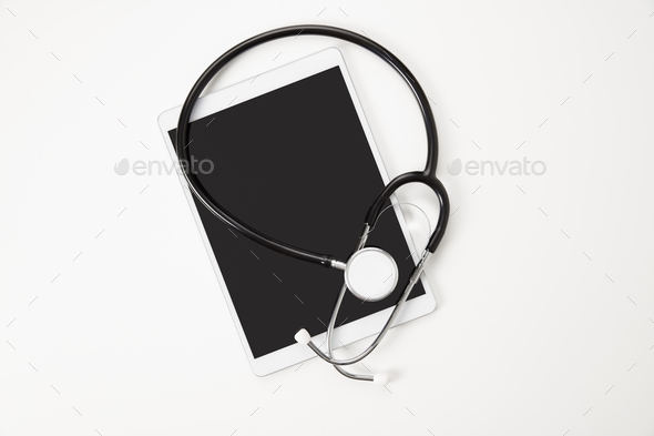 Digital Tablet And Stethoscope On White Table - Stock Photo - Images