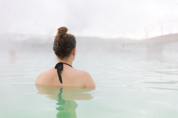 Woman Relaxing In Blue Lagoon At Iceland - Stock Photo - Images