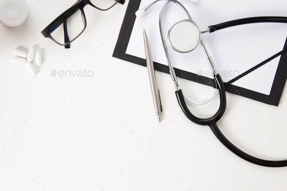 Doctors Office Desk with Thermometer And Medical Instruments On White - Stock Photo - Images