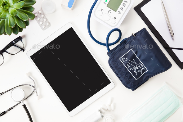 Digital Tablet With Blood Pressure Machine And Other Medical Ins - Stock Photo - Images