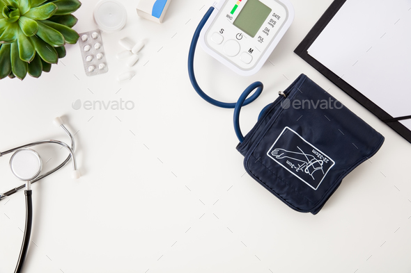 Blood Pressure Machine With Stethoscope And Clipboard On White T - Stock Photo - Images
